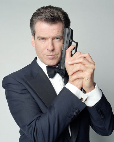 Pierce Brosnan as James Bond in black butterfly bow tie.