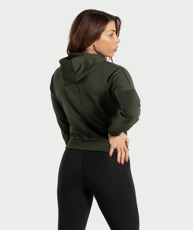 BELLY ARMY-GREEN CROPPED HOODIE WITH FULL LENGTH ZIPPER IS WITH COTTON AND POLYESTER BLENDED FABRIC THAT MAKES IT SUITABLE FOR ALL ACTIVITIES .WINNERFORCE LOGO IS PRINTED TO SHOULDER .THE RIBBED HEM AND CUFFS ADD SOME STYLE TO YOUR TRAINING HOODIE.YOU CAN PAIR IT WITH ANY PANTS EVEN CASUAL ONE.