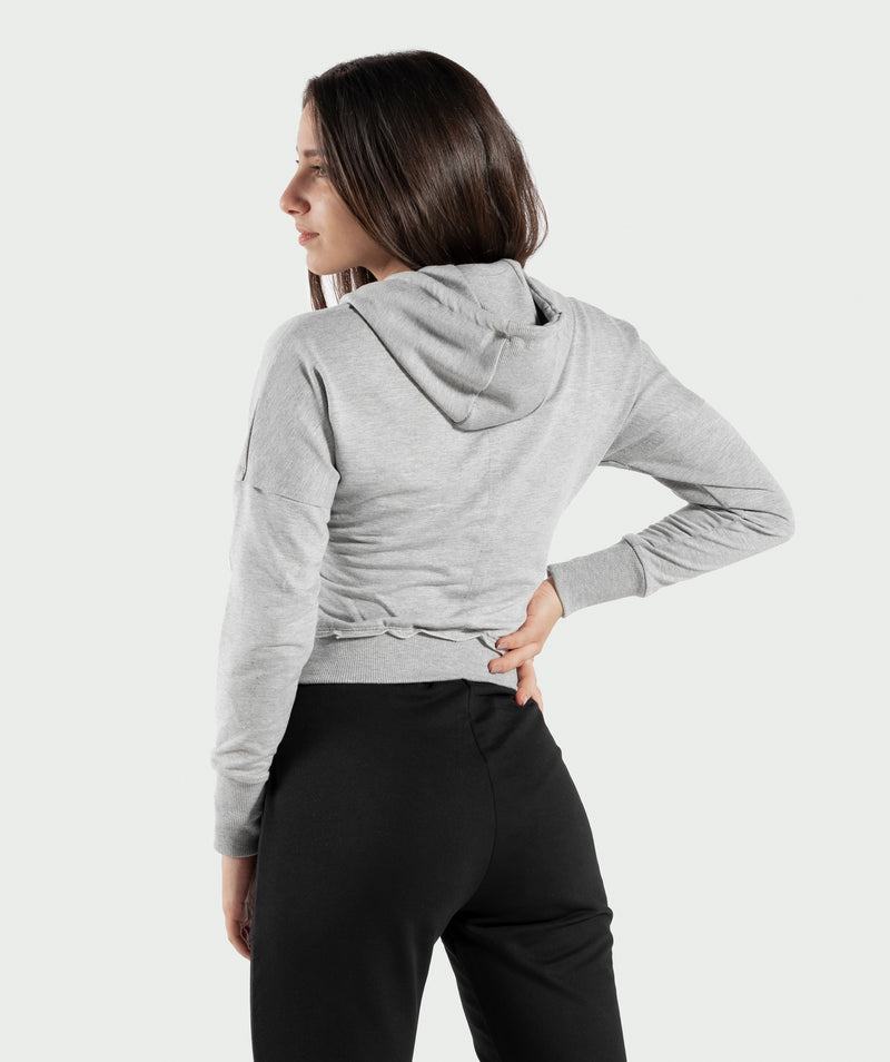 BELLY LIGHT-GREY CROPPED HOODIE WITH FULL LENGTH ZIPPER IS WITH COTTON AND POLYESTER BLENDED FABRIC THAT MAKES IT SUITABLE FOR ALL ACTIVITIES .WINNERFORCE LOGO IS PRINTED TO SHOULDER .THE RIBBED HEM AND CUFFS ADD SOME STYLE TO YOUR TRAINING HOODIE.YOU CAN PAIR IT WITH ANY PANTS EVEN CASUAL ONE.