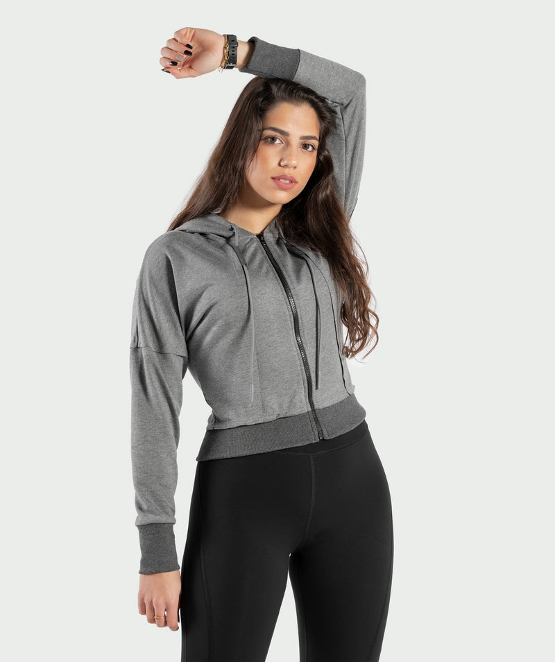 BELLY DARK-GREY CROPPED HOODIE WITH FULL LENGTH ZIPPER IS WITH COTTON AND POLYESTER BLENDED FABRIC THAT MAKES IT SUITABLE FOR ALL ACTIVITIES .WINNERFORCE LOGO IS PRINTED TO SHOULDER .THE RIBBED HEM AND CUFFS ADD SOME STYLE TO YOUR TRAINING HOODIE.YOU CAN PAIR IT WITH ANY PANTS EVEN CASUAL ONE.