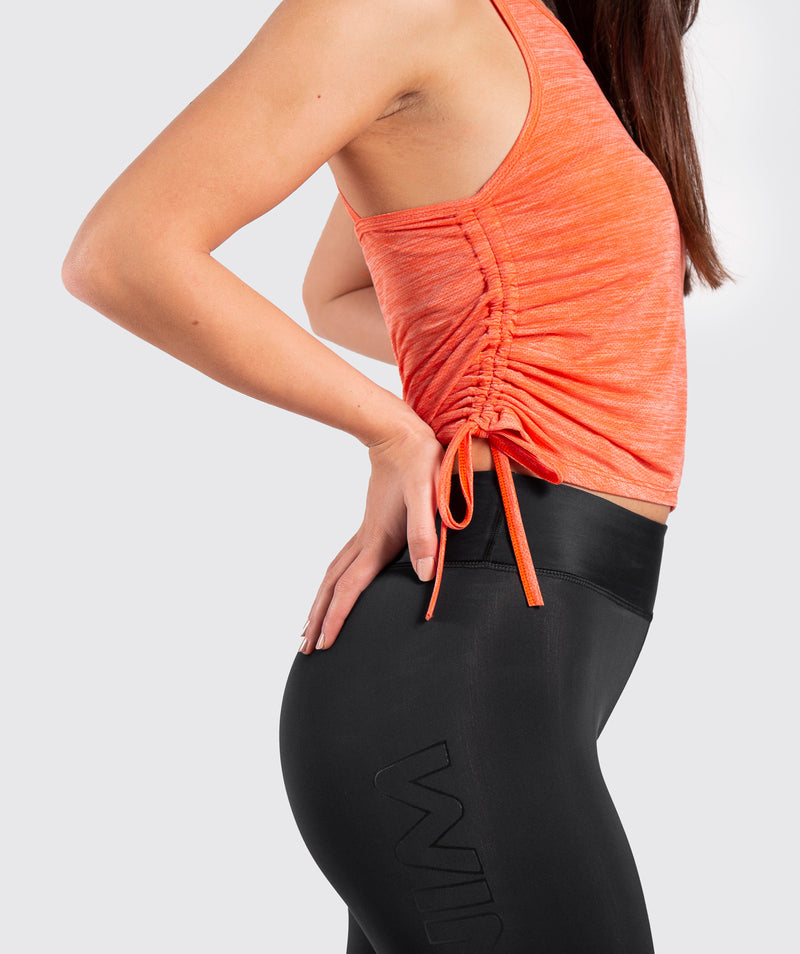 CUTELIA MARL ORANGE TANK TOP MADE OF 100% POLYESTER WITH ANTI-SHRINKING FEATURE .YOU CAN SPEND YOUR HARD SESSIONS OF LIFTING ,CARDIO OR GYMNASTIC WITH A HIGH SUPPORT TANK TOP.IT IS DELIVERED WITH WINNERFORCE LOGO TO CHEST.IT IS WITH ADJUSTABLE FEATURE SO YOU CAN CONTROL THE DESIRED LENGTH .