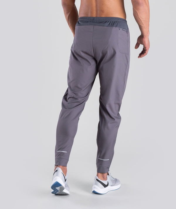 THE ATHLES GREY PANT ARE VERY COMFORTABLE WITH YKK ZIPPER AND A REFLECTIVE LOGO TO THE LEFT LEG.YOU CAN WEAR IT WHILE LIFT ING ,RUNNING OR ANY SPORTS ACTIVITY.