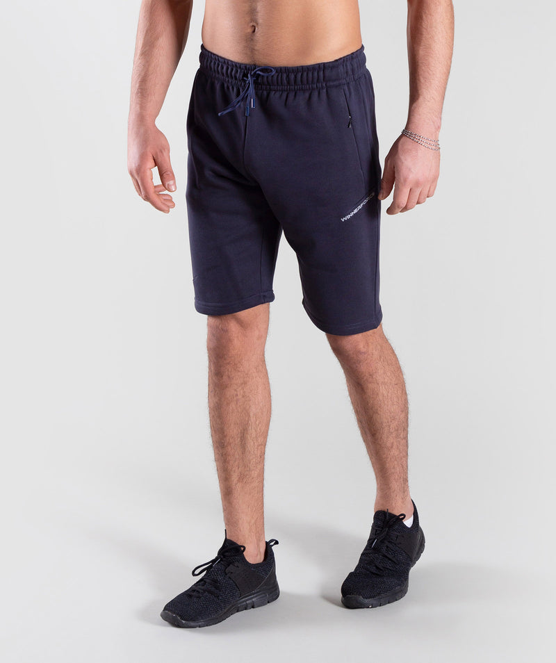 POTENZO NAVY SHORTS ARE WITH LIGHTWEIGHT FABRIC TO ENSURE YOUR MAXIMUM MOVEMENT AND EXERTION THROUGHT TRAINING.THESE NAVY SHORTS ARE MADE WITH COTTON FABRIC WITH WINNERFORCE LOGO PRINTED IN WHITE COLOR TO THE LEFT LEG.ITS NOT TALL NEAR SHORT LENGTH.WITH WINNERFORCE LOGO BRANDED ON LACES WILL GIVE YOU POWER DURING YOUR PERFORMANCE.