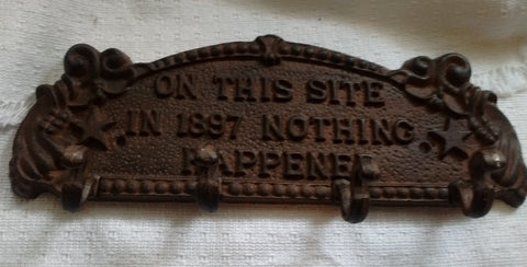Cast Iron  -  Ornate Cast Iron Sign - Nothing Happened 1897 Free Shipping