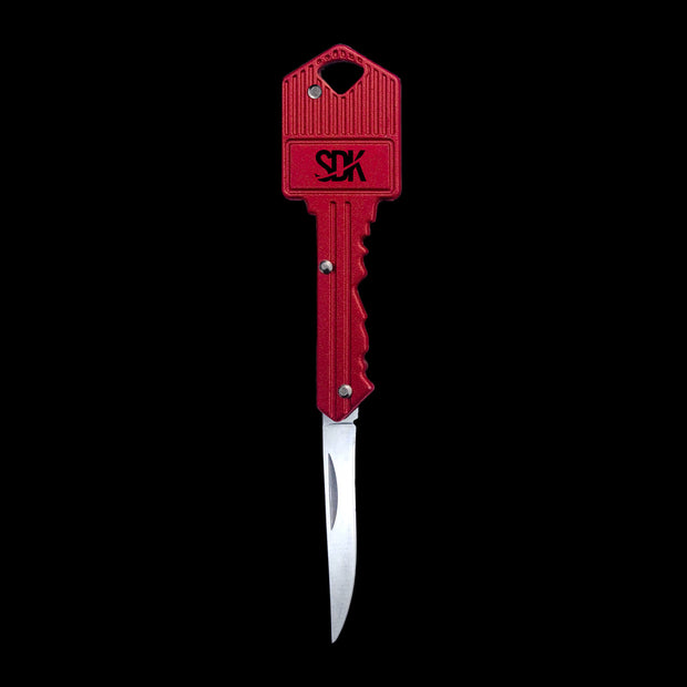 SDK Key Knife Red, open position (stainless steel key-shaped flip knife)