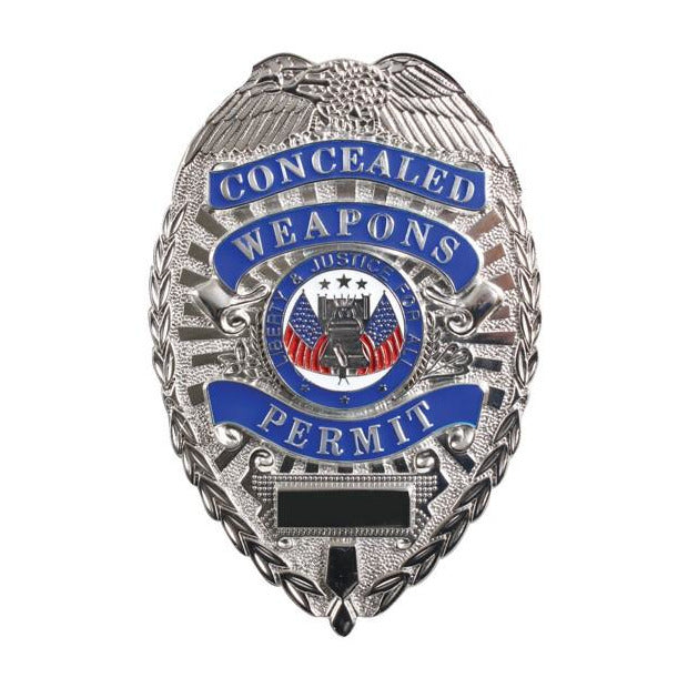 "Front view of the silver concealed carry gear badge that says ""Concealed Weapons Permit"" on the front."