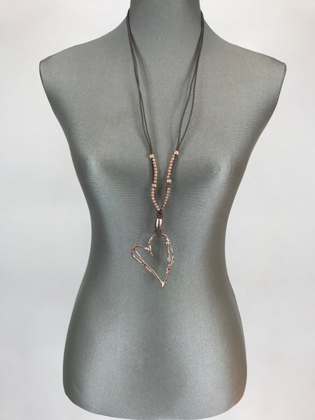 Laenlook Irregular cutout heart pendant on long leather necklace in Gold . Reo202