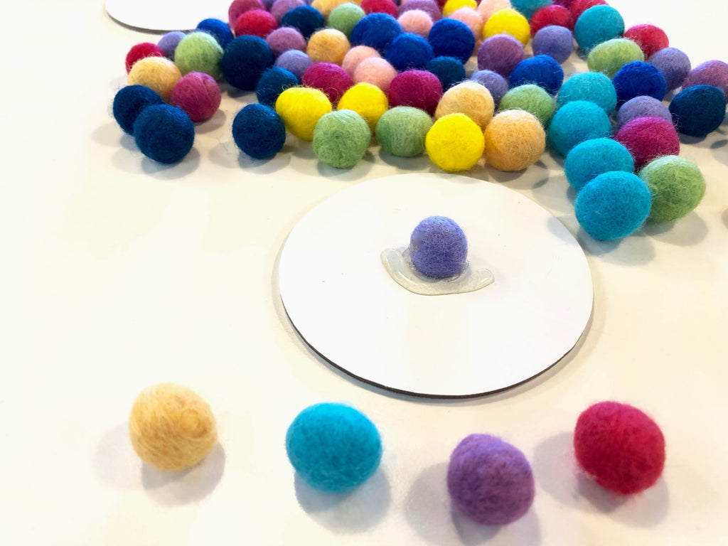 4 selected Wool Pom Poms
