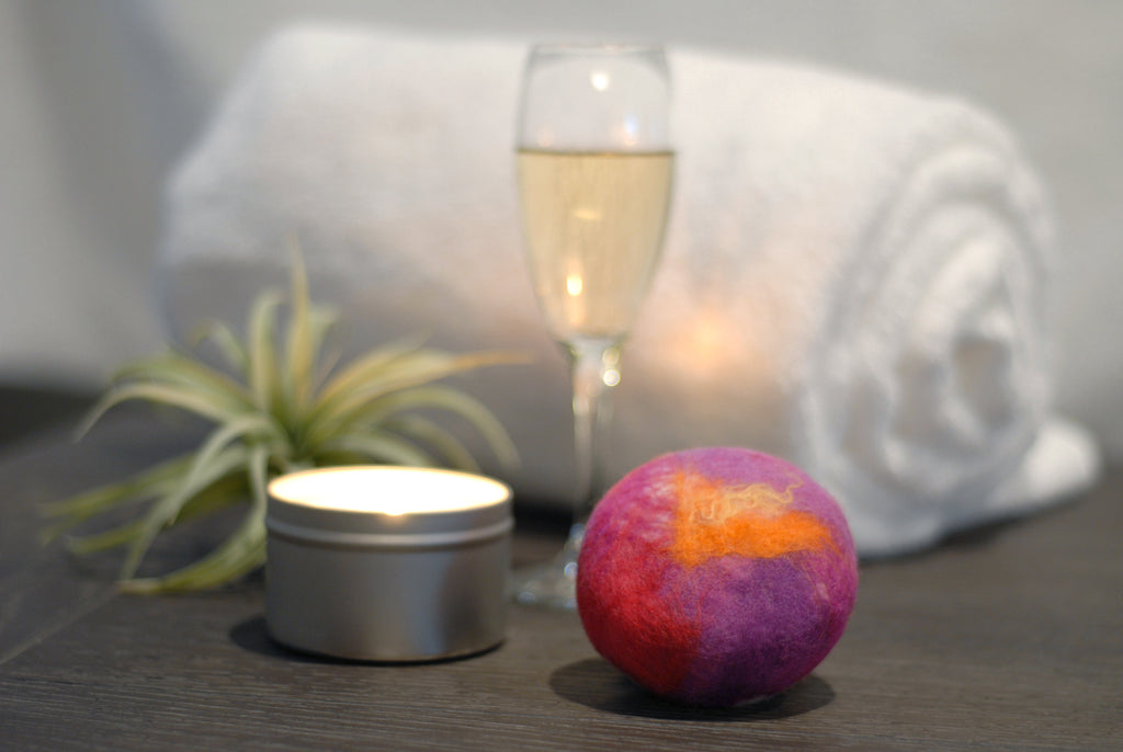Felted soap with candle, champagne, and towel
