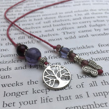 Load image into Gallery viewer, A beaded string bookmark with a silver butterfly and tree-of-life charm.