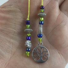 Load image into Gallery viewer, A beaded string bookmark with a silver tree-of-life charm.