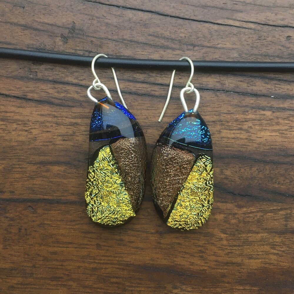 A pair of fused-glass earrings with dichroic sections.