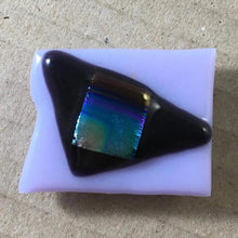 Load image into Gallery viewer, A lilac and black fused-glass magnet with blue dichroic features.