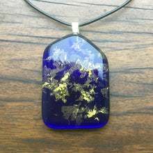 Load image into Gallery viewer, A blue fused-glass pendant with 24-carat gold flakes.