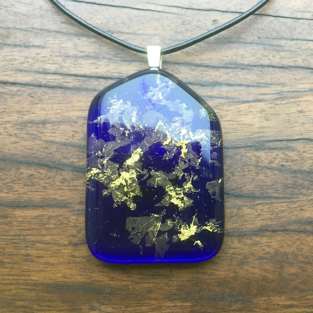 A blue fused-glass pendant with 24-carat gold flakes.
