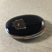 Load image into Gallery viewer, A dark red-black fused-glass magnet with dichroic features and tinned-copper wrap.