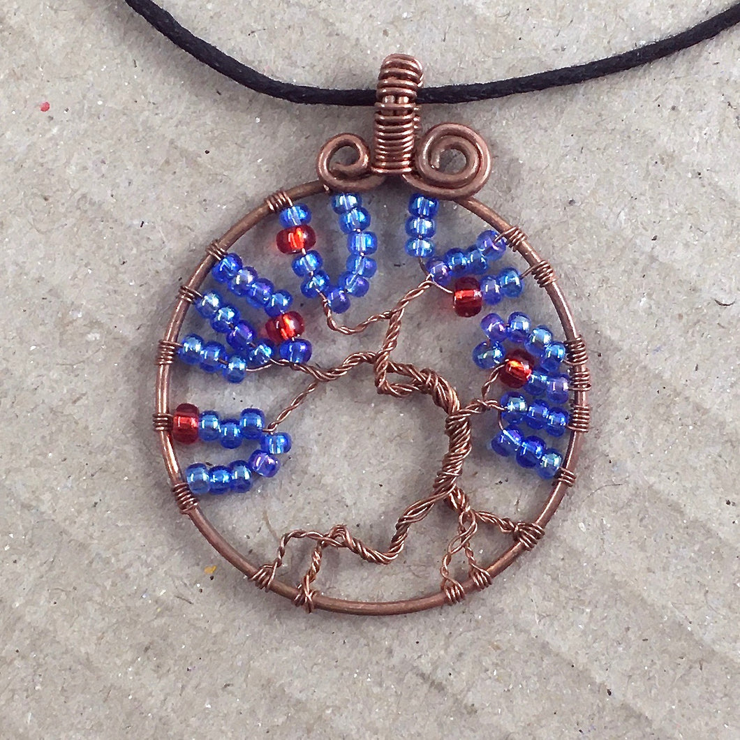 Tree-of-life pendant with copper wire and blue/red beads. Cherry Tree.