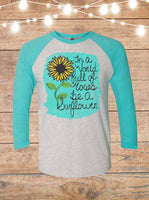 In A World Full Of Roses Be A Sunflower Raglan T-Shirt