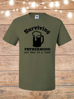 Surviving Fatherhood One Beer At A Time T-Shirt