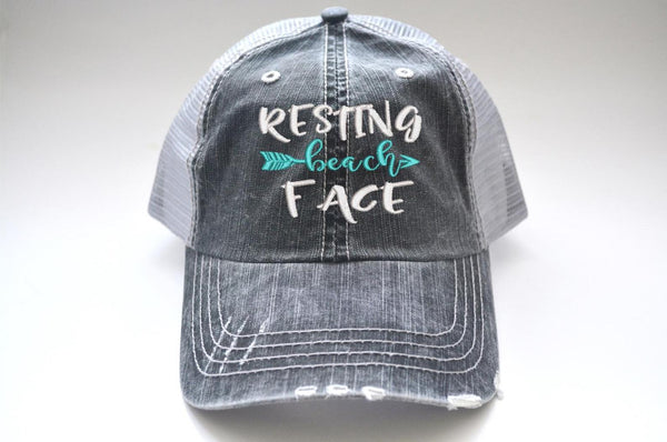 Resting Beach Face Arrow Trucker Hat