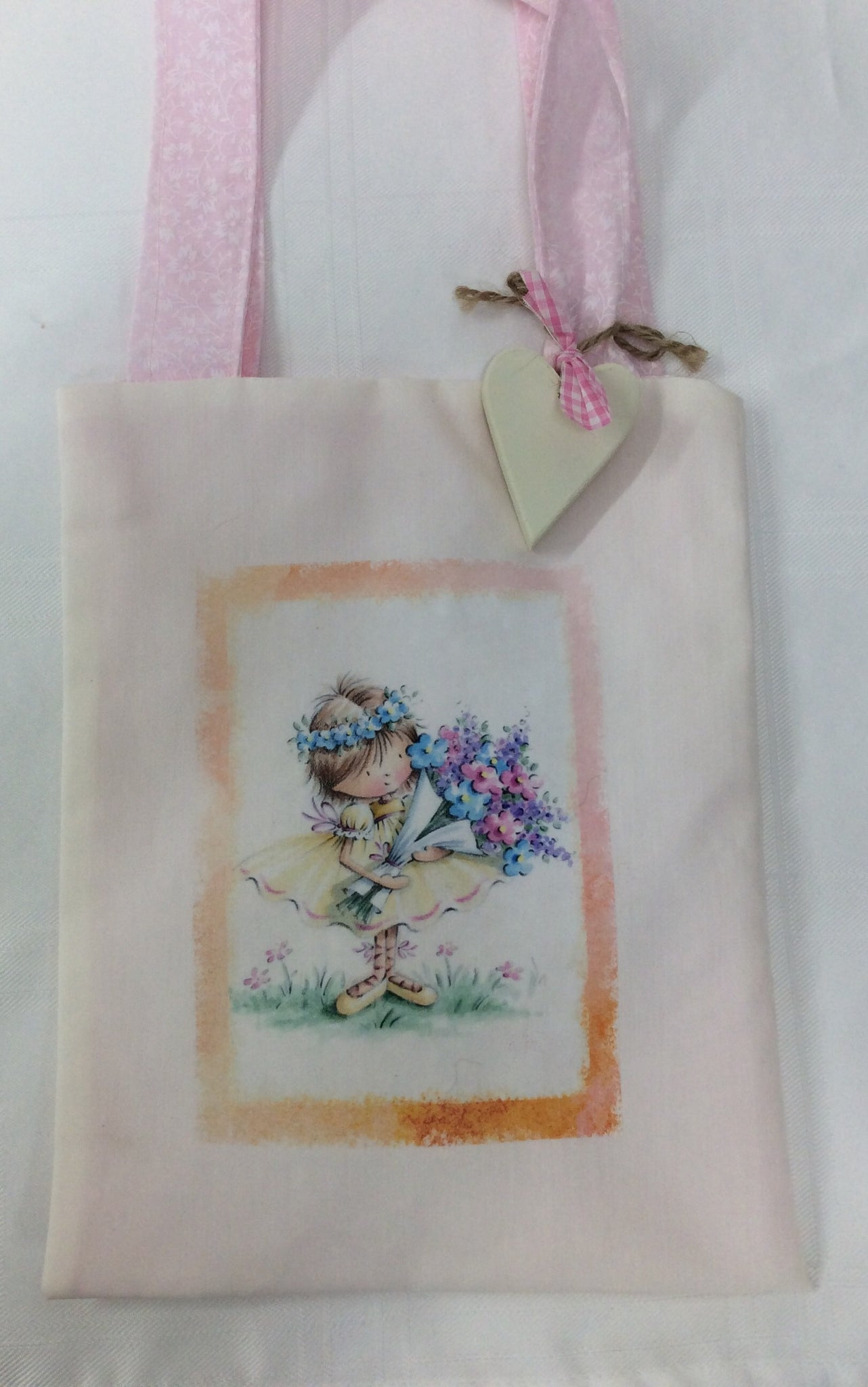 Handmade children's bag with personalised wooden heart featuring fairy holding flowers
