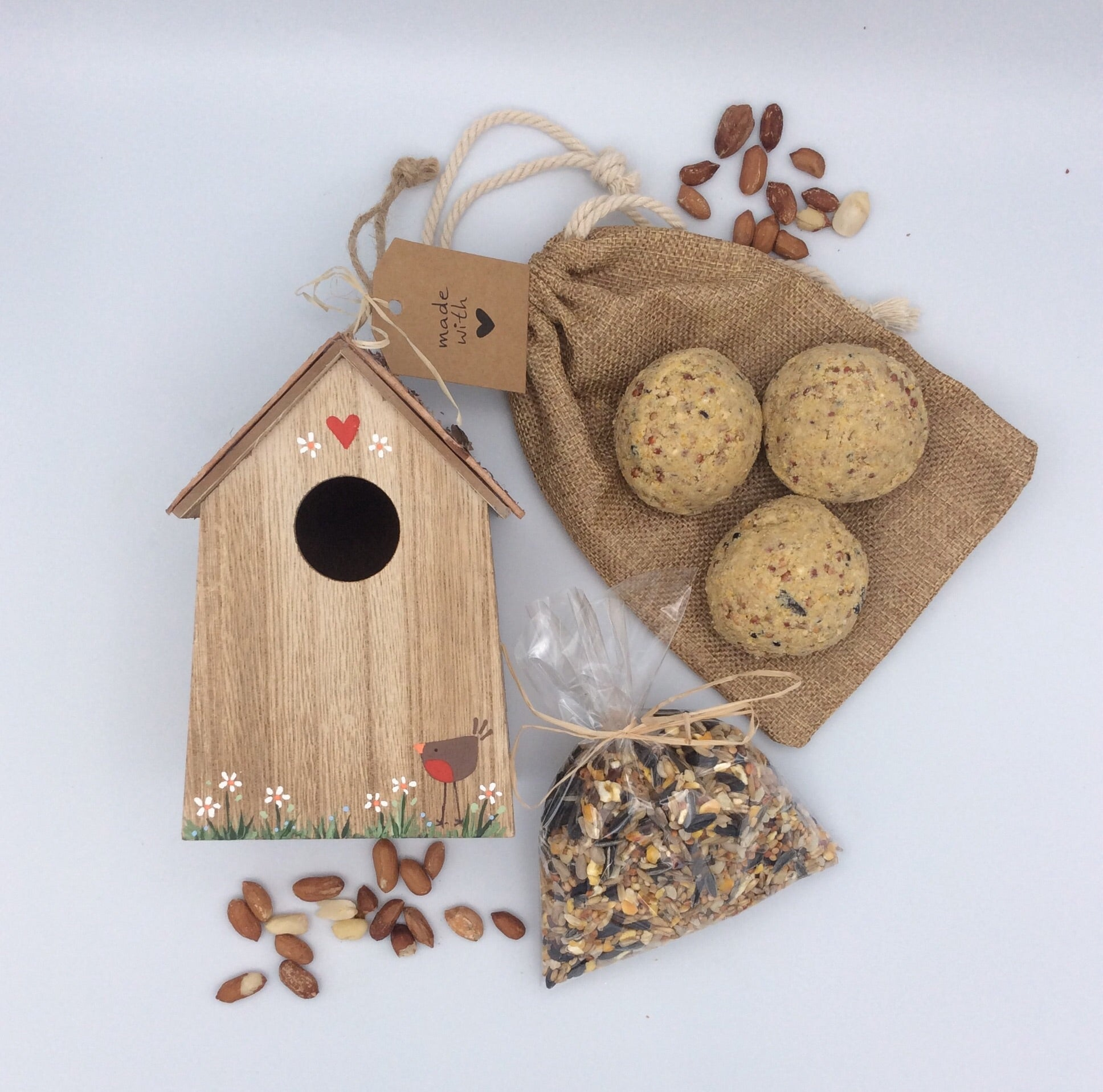 Hand painted bird box and bird seed gift set.