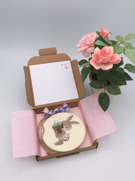 Bunny holding a plant pot keepsake card and gift in one