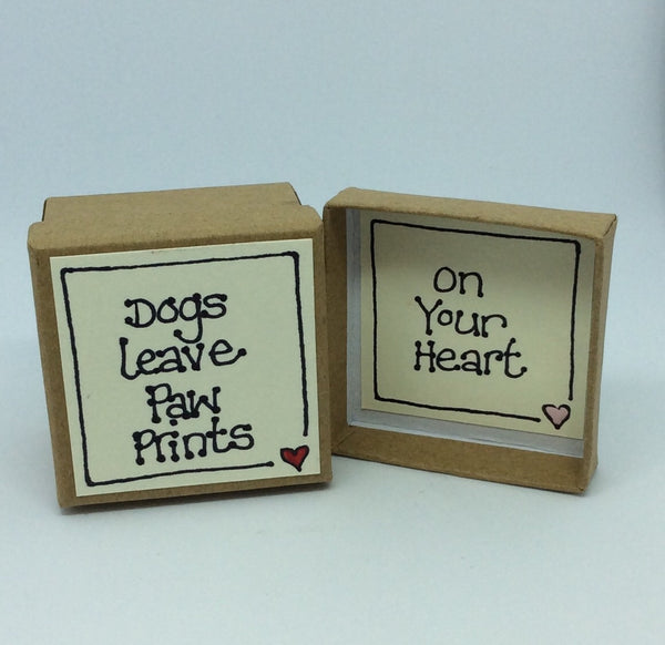 Little dog in a box dogs leave paw prints on your heart.