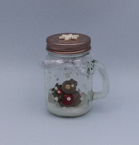 Beautiful handmade porcelain robin sat in a snow filled jar