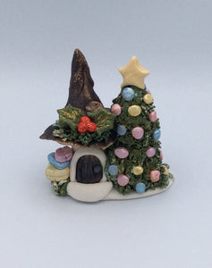 Beautiful handmade Christmas cottage with tree