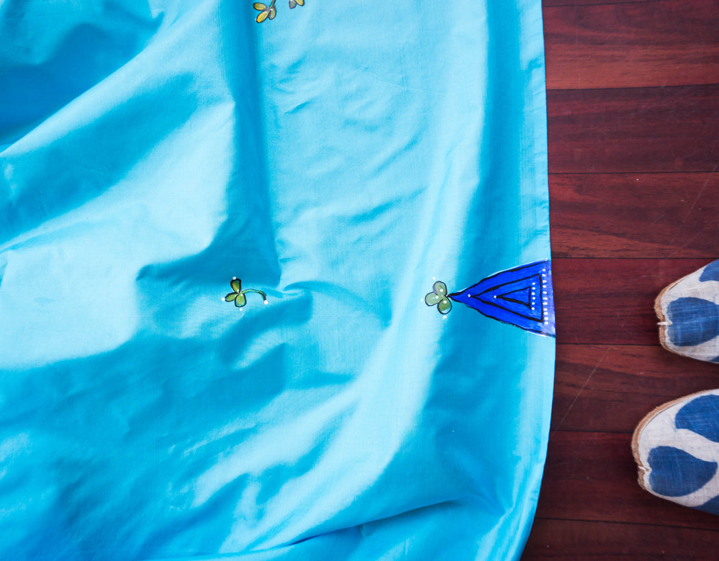 art on a blue silk dupatta