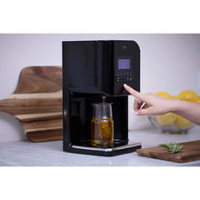 Load image into Gallery viewer, Levo 2 Oil Infuser Jet Black Lifestyle