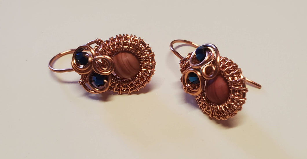 Copper non tarnish earrings with a sunstone focal bead and Blue Swarovski crystals
