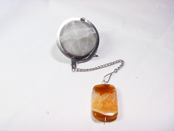Tea infuser with dyed orange agate charm