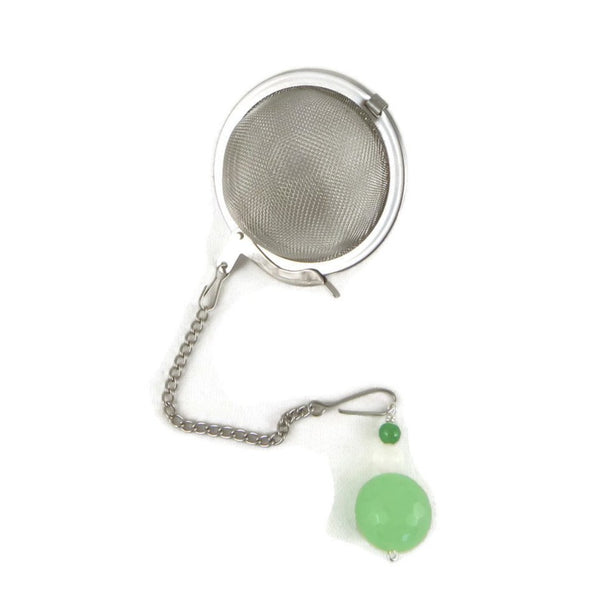 Tea infuser with a green beaded charm