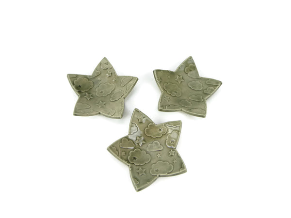Smokey grey star shaped trivet with star and cloud pattern
