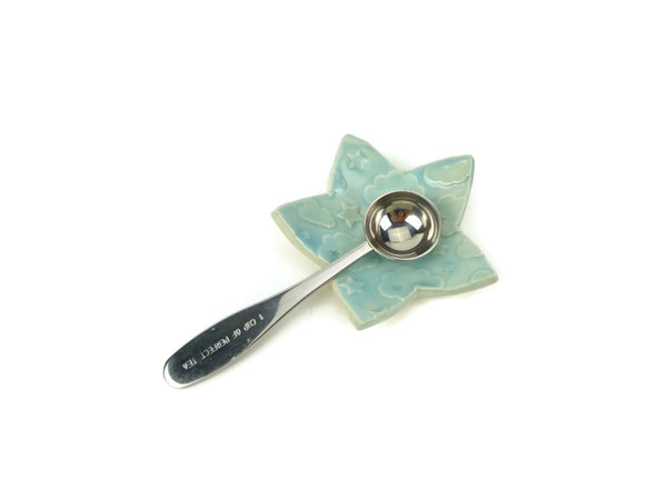 Light blue star shaped trivet with star and cloud pattern