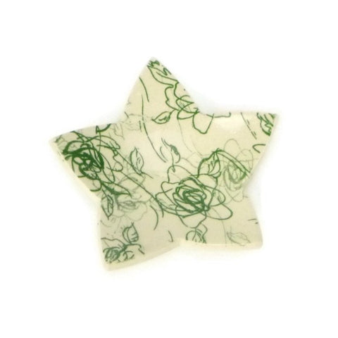 Star shaped trivet with green rose patterning