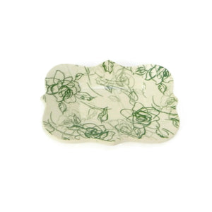 Large scalloped trivet with green rose patterning