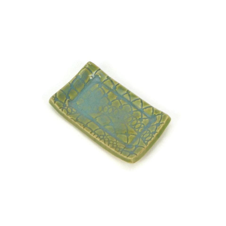 Turquoise and green lace patterned rectangle trivet