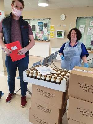 Brian Kenny donates several boxes of hand sanitiser to Irish hospital workers on behalf of W.I. Polymers and Hand Sanitiser Ireland.
