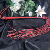 The Black and red FlipCat™ Flexible Braided Cat-O-Nine Whip