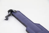 A closeup of the handle of the Prince Blurple Leather Paddle.