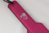 A closeup of the handle of the Nicki Pink Leather Paddle.