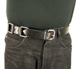 The torso of a man wearing a black t-shirt and black jeans with the Restraint Trick Belt through the loops of his jeans.
