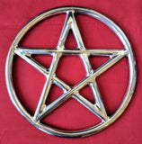 A steel suspension ring with a pentagram inside it.