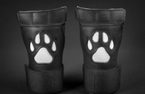Close up of black/white open paw puppy gloves.