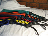 Another angle of Deertan cowhide Floggers in various colors.