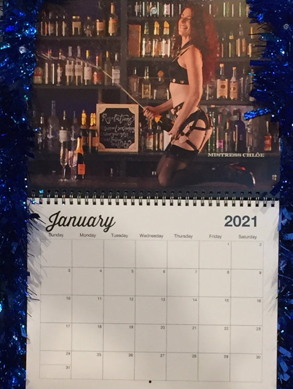 January 2021 - Mistress Chloe poses on a bar with a bottle of champagne.