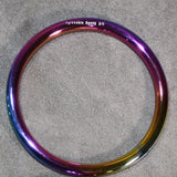 A rainbow colored steel suspension ring.